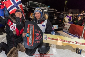 Joar Leifseth Ulsom recieves his Dodge Ram Winner's truck from Chuck Talskey of Anchorage Chrysler Dodge at the finish line in Nome, Alaska early on Wednesday morning March 14th as he wins the 46th running of the 2018 Iditarod Sled Dog Race.  He finished in 9 days 12 hours 00 minutes and 00 secondsPhoto by Jeff Schultz/SchultzPhoto.com  (C) 2018  ALL RIGHTS RESERVED