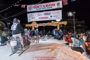 Nick Petit at the finish line in Nome, Alaska early on Wednesday morning March 14th as places 2nd in the 46th running of the 2018 Iditarod Sled Dog Race.  Photo by Jeff Schultz/SchultzPhoto.com  (C) 2018  ALL RIGHTS RESERVED