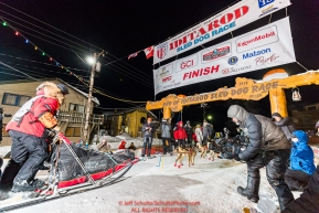 Mitch Seavey runs into the chute at the finish line in Nome, Alaska early on Wednesday morning March 14th as he places 3rd in the 46th running of the 2018 Iditarod Sled Dog Race.  Photo by Jeff Schultz/SchultzPhoto.com  (C) 2018  ALL RIGHTS RESERVED
