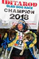 Joar Leifseth Ulsom poses with his lead dogs Russeren (left) and Olive on the winner's podium at the finish line in Nome, Alaska early on Wednesday morning March 14th as he wins the 46th running of the 2018 Iditarod Sled Dog Race.  He finished in 9 days 12 hours 00 minutes and 00 secondsPhoto by Jeff Schultz/SchultzPhoto.com  (C) 2018  ALL RIGHTS RESERVED