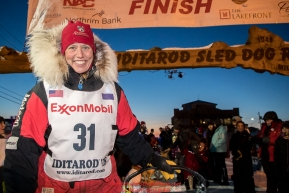 Aliy Zirkle poses at the finish line in Nome after completing the race in 15th place on Wednesday March 14th during the 2018 Iditarod Sled Dog Race.  Photo by Jeff Schultz/SchultzPhoto.com  (C) 2018  ALL RIGHTS RESERVED