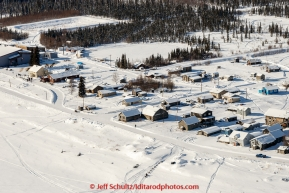 A team arrives off the Yukon River into the Nulato checkpoint on the afternoon of Sunday  March 15, 2015 during Iditarod 2015.  (C) Jeff Schultz/SchultzPhoto.com - ALL RIGHTS RESERVED DUPLICATION  PROHIBITED  WITHOUT  PERMISSION
