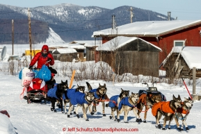 Travis Beals has a sled full of gear as he leaves the Kaltag checkpoint on his 90 mile run to Unalakleet in the afternoon of Sunday  March 15, 2015 during Iditarod 2015.  (C) Jeff Schultz/SchultzPhoto.com - ALL RIGHTS RESERVED DUPLICATION  PROHIBITED  WITHOUT  PERMISSION
