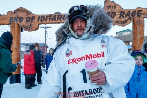 Ray Redington Jr. poses at the finish line in Nome after finishing in 7th place during the 2017 Iditarod on Wednesday March 15, 2017.Photo by Jeff Schultz/SchultzPhoto.com  (C) 2017  ALL RIGHTS RESERVED