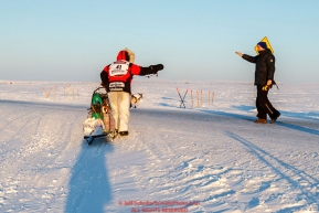 Aliy Zirkle waves to a well-wisher as she crosses a road on her run into Nome during the 2017 Iditarod on Wednesday March 15, 2017.Photo by Jeff Schultz/SchultzPhoto.com  (C) 2017  ALL RIGHTS RESERVED