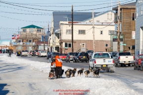 Pete Kaiser runs down Front Street in Nome with a police escort on his way to a 9th place finish during the 2017 Iditarod on Wednesday March 15, 2017.Photo by Jeff Schultz/SchultzPhoto.com  (C) 2017  ALL RIGHTS RESERVED