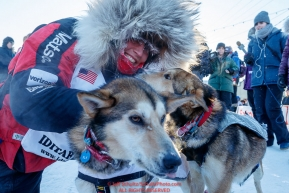 Shorlty after finishing in 8th place, Aliy Zirkle hugs her lead dogs Dutch and Sparky in the finish chute in Nome during the 2017 Iditarod on Wednesday March 15, 2017.Photo by Jeff Schultz/SchultzPhoto.com  (C) 2017  ALL RIGHTS RESERVED