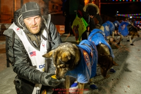 Noah Burmeister poses with his lead dogs at the finish line in Nome shortly after finishing in 29th place during the 2017 Iditarod on Thursday March 16, 2017.Photo by Jeff Schultz/SchultzPhoto.com  (C) 2017  ALL RIGHTS RESERVED