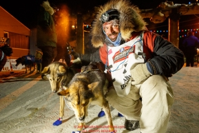 Cody Strathe poses with his lead dogs after he arrived at the finish line in Nome in 30th place during the 2017 Iditarod on Thursday March 16, 2017.Photo by Jeff Schultz/SchultzPhoto.com  (C) 2017  ALL RIGHTS RESERVED