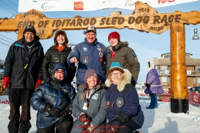 The drug testing team (AKA P-Team) poses for a group photo at the finish line in Nome during the 2017 Iditarod on Thursday March 16, 2017.Photo by Jeff Schultz/SchultzPhoto.com  (C) 2017  ALL RIGHTS RESERVED