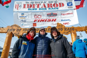 The three Redington Brothers, Ryan, Robert and Ray Jr. , pose at the finish line in Nome after they finished the 2017 Iditarod on Thursday March 16, 2017.Photo by Jeff Schultz/SchultzPhoto.com  (C) 2017  ALL RIGHTS RESERVED
