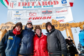 The three  Redington Brothers, Ryan, Robert and Ray Jr.  and their dad Raymie pose at the finish line in Nome during the 2017 Iditarod on Thursday March 16, 2017.Photo by Jeff Schultz/SchultzPhoto.com  (C) 2017  ALL RIGHTS RESERVED
