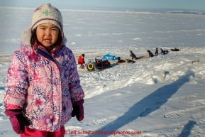Young Savannah Paniptchuk watches the teams rest at the Shaktoolik checkpoint on Tuesday March 16, 2015 during Iditarod 2015.  (C) Jeff Schultz/SchultzPhoto.com - ALL RIGHTS RESERVED DUPLICATION  PROHIBITED  WITHOUT  PERMISSION