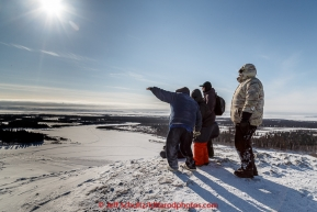 Tourists watch for Mitch Seavey from the hill at White Mountain over looking the Fish River at the White Mountain checkpoint on Tuesday March 16, 2015 during Iditarod 2015.  (C) Jeff Schultz/SchultzPhoto.com - ALL RIGHTS RESERVED DUPLICATION  PROHIBITED  WITHOUT  PERMISSION
