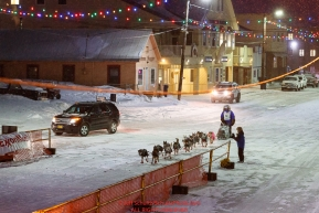 Geir Idar Hjelvik runs down Front Street in Nome on his way to 45th place and the finish line in Nome during the 2017 Iditarod on Friday March 17, 2017.Photo by Jeff Schultz/SchultzPhoto.com  (C) 2017  ALL RIGHTS RESERVED