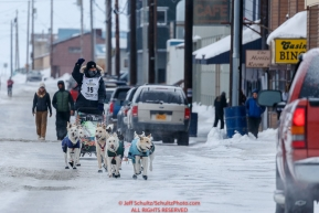 Gunnar Johnson runs down Front Street on the way to the finish line in Nome  during the 2017 Iditarod on Friday March 17, 2017.Photo by Jeff Schultz/SchultzPhoto.com  (C) 2017  ALL RIGHTS RESERVED