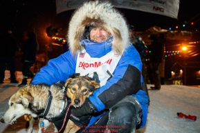 Geir Idar Hjelvik poses with his lead dogs at the finish line in Nome arriving in 45th place during the 2017 Iditarod on Friday March 17, 2017.Photo by Jeff Schultz/SchultzPhoto.com  (C) 2017  ALL RIGHTS RESERVED