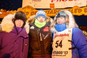 Three Norwegian mushers Ketil Reitan, Joar Leifseth Ulsom and Geir Idar Hjelvik at the finish line in Nome after Geir arrived in 45th place during the 2017 Iditarod on Friday March 17, 2017.Photo by Jeff Schultz/SchultzPhoto.com  (C) 2017  ALL RIGHTS RESERVED