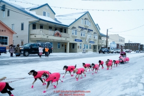 DeeDee Jonrowe runs down Front Street on the way to the finish line in Nome  during the 2017 Iditarod on Friday March 17, 2017.Photo by Jeff Schultz/SchultzPhoto.com  (C) 2017  ALL RIGHTS RESERVED