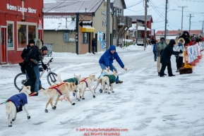 Gunnar Johnson gets help coming off of Front Street and into the finish chute in Nome  during the 2017 Iditarod on Friday March 17, 2017.Photo by Jeff Schultz/SchultzPhoto.com  (C) 2017  ALL RIGHTS RESERVED