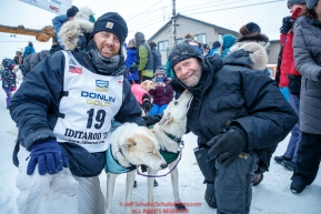Gunnar Johnson poses at the finish line with his lead dogs Delta and Queen along with the dog's owner, Iditarod musher Jim Lanier in Nome  during the 2017 Iditarod on Friday March 17, 2017.Photo by Jeff Schultz/SchultzPhoto.com  (C) 2017  ALL RIGHTS RESERVED