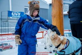 A young race fan pets a Gunna Johnson dog at the finish line in Nome  during the 2017 Iditarod on Friday March 17, 2017.Photo by Jeff Schultz/SchultzPhoto.com  (C) 2017  ALL RIGHTS RESERVED