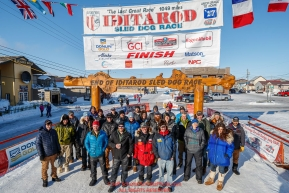 Some of the official finishers of the 2017 race pose for a group photo in the finish chute in Nome during the 2017 Iditarod on Saturday March 18, 2017.Photo by Jeff Schultz/SchultzPhoto.com  (C) 2017  ALL RIGHTS RESERVED