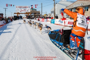 Last place finisher and Red Lantern Award winner Cindy Abbott holds up the red lantern as she runs down the finish chute in Nome during the 2017 Iditarod on Saturday March 18, 2017.Photo by Jeff Schultz/SchultzPhoto.com  (C) 2017  ALL RIGHTS RESERVED