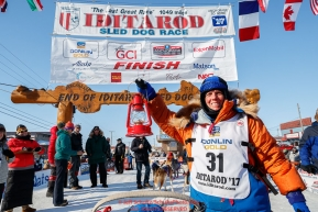 Last place finisher and Red Lantern Award winner Cindy Abbott holds up the red lantern after her finish in Nome during the 2017 Iditarod on Saturday March 18, 2017.Photo by Jeff Schultz/SchultzPhoto.com  (C) 2017  ALL RIGHTS RESERVED