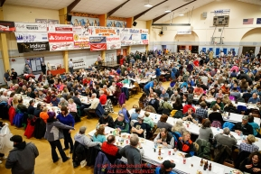 A packed house enjoys the Nome Musher's Award Banquet at the city recreation center during the 2017 Iditarod on Sunday March 19, 2017.Photo by Jeff Schultz/SchultzPhoto.com  (C) 2017  ALL RIGHTS RESERVED