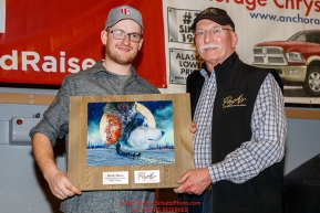 The PenAir Spirit of Alaska Award is Presented by Dave Hall, chief operating officer of PenAir to Wade Marrs at the Nome Musher's Award Banquet during the 2017 Iditarod on Sunday March 19, 2017.Photo by Jeff Schultz/SchultzPhoto.com  (C) 2017  ALL RIGHTS RESERVED