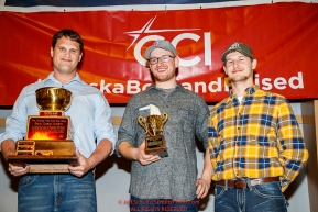 The Wells Fargo Gold Coast Award is presented by Drew McCann, Nome branch manager, and Jake Slingsby,vice president and senior business relationship manager,forWells Fargo to Wade Marrs at the Nome Musher's Award Banquet during the 2017 Iditarod on Sunday March 19, 2017.Photo by Jeff Schultz/SchultzPhoto.com  (C) 2017  ALL RIGHTS RESERVED
