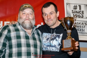 The Jerry Austin Memorial Rookie of the YearAward is presented on behalf of the Austin family by race marshal Mark Nordman to Sebastien Vergnaud at the Nome Musher's Award Banquet during the 2017 Iditarod on Sunday March 19, 2017.Photo by Jeff Schultz/SchultzPhoto.com  (C) 2017  ALL RIGHTS RESERVED
