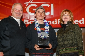 The Matson Most Improved Musher Award is resented by Tamara Grasse, senior account manager for Matson and Don Grasse to Ryan Redington at the Nome Musher's Award Banquet during the 2017 Iditarod on Sunday March 19, 2017.Photo by Jeff Schultz/SchultzPhoto.com  (C) 2017  ALL RIGHTS RESERVED