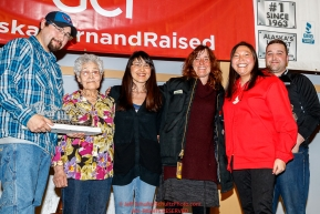 The Northern Air Cargo Herbie Nayokpuk Memorial Award is presented by Ross St. John, outside sales manager, and Cheryl Johnson, director of community relations for Northern Air Cargo as well as members of the Nayokpuk family including Herbie's widow Elizabeth to Michelle Phillips at the Nome Musher's Award Banquet during the 2017 Iditarod on Sunday March 19, 2017.Photo by Jeff Schultz/SchultzPhoto.com  (C) 2017  ALL RIGHTS RESERVED
