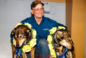 First place winner Mitch Seavey poses with his lead dogs Crisp and Pilot at the musher awards ceremony  in Nome during the 2017 Iditarod on Sunday March 19, 2017.Photo by Jeff Schultz/SchultzPhoto.com  (C) 2017  ALL RIGHTS RESERVED
