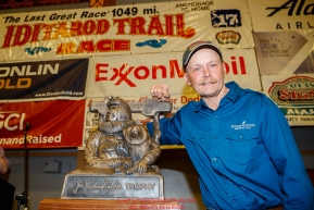 First place winner Mitch Seavey poses with the first place trophy, The Redington Trophy, at the musher awards ceremony  in Nome during the 2017 Iditarod on Sunday March 19, 2017.Photo by Jeff Schultz/SchultzPhoto.com  (C) 2017  ALL RIGHTS RESERVED
