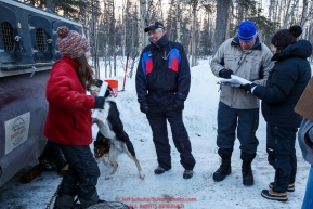 Part of the volunteer veterinarian team talks with musher Kristin Bacon at the pre-race vet-check for dogs running this year's 2017 Iditarod at Iditarod Headquarters in Wasilla, Alaska.  Wednesday March 1, 2017Photo by Jeff Schultz/SchultzPhoto.com  (C) 2017  ALL RIGHTS RESVERVED