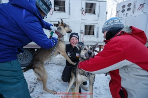 Rookie musher Laura Neese (center) holds two of her dogs as they are examined by volunteer race veterinarians at the pre-race vet-check for dogs running this year's 2017 Iditarod at Iditarod Headquarters in Wasilla, Alaska.  Wednesday March 1, 2017Photo by Jeff Schultz/SchultzPhoto.com  (C) 2017  ALL RIGHTS RESVERVED