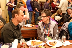 Musher Charlie Benja (left) talks with his Iditarider during a pizza lunch after the mandatory musher meeting at the Lakefront Anchorage hotel Thursday March 2, 2017 two days prior to the start of the 2017 Iditarod.Photo by Jeff Schultz/SchultzPhoto.com  (C) 2017  ALL RIGHTS RESVERVED