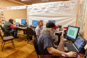 Race Comms volunteers Bryan Nelson, Patty Montague and Reece J. Roberts configure checkpoint computers at the race headquarters at the Lakefront Anchorage hotel on Thursday March 2, 2017 two days prior to Iditarod 2017.Photo by Jeff Schultz/SchultzPhoto.com  (C) 2017  ALL RIGHTS RESVERVED