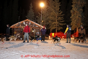 Volunteers hold Michele Phillips dogs at the Rohn checkpoint during the 2013 Iditarod sled Dog Race   March 4, 2013.  Photo by Jeff Schultz Do Not Reproduce without permission