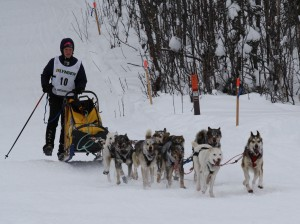 Conway Seavey adds thrust by poling and pedaling his team to the Junior Finish Line