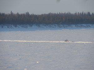 Trail breaker heading down the Yukon