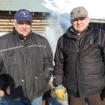 Fred Bifelt and Joe Ambrose standing in front of Huslia's Tribal Hall